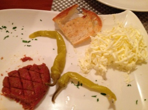 That's not cheese with our minced meat tartar appetizer, its butter...